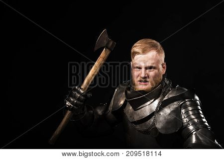 Knight In Armour With Axe On The Black Background