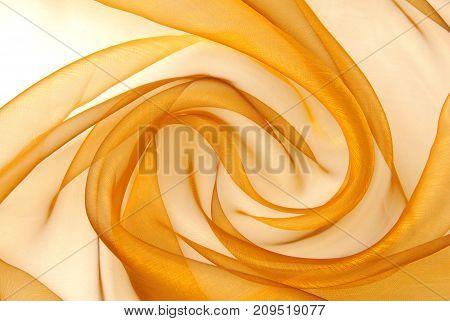 closeup of the golden organza fabric wavy texture