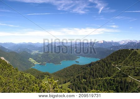 A perspective from Herzogstand, Germany, Bayern. Lake with montains in the background.