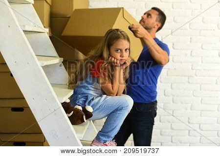 Daughter With Bear Sit On Ladder And Father Puts Box