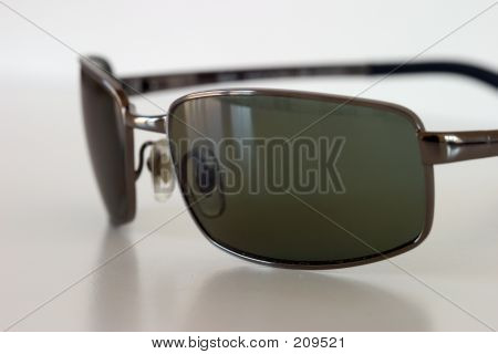Sunglasses Sitting On A White Surface