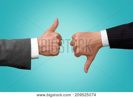 Thumb thumbs up thumbs down hand sign close-up closeup business