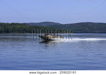 HIGH COAST WORLD HERITAGE, SWEDEN ON AUGUST 06. View of the seascape and military speedboat on August 06, 2009 in Mjallomslandet, High Coast World Heritage, Sweden. Unidentified people. Editorial use.
