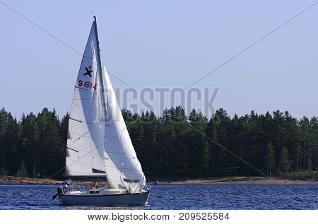 HIGH COAST WORLD HERITAGE, SWEDEN ON AUGUST 07. View of sailboat on August 07, 2009 in the High Coast World Heritage, Sweden. Unidentified people sailing. Editorial use.