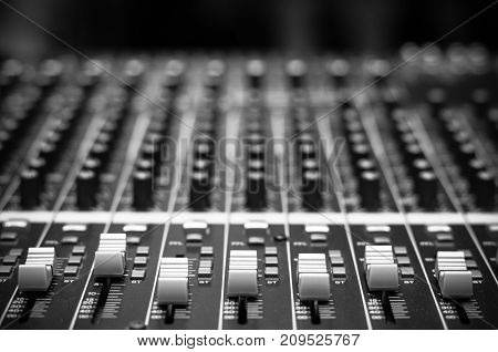 audio mixer music equipment and instrument on black and white tone