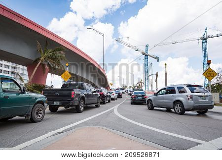 Miami Florida USA September 20 2017: Cars on the roads. Vehicles driving up to the draw bridge.