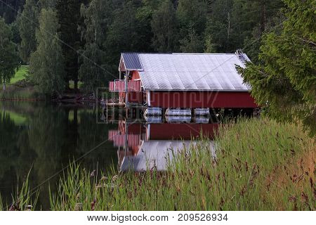 HIGH COAST WORLD HERITAGE, SWEDEN ON AUGUST 05. View of a classic red cabin, rorbu on August 05, 2009 in High Coast World Heritage, Sweden. Reed this side. Editorial use.