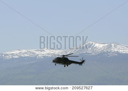 Sofia, Bulgaria - 3, May 2017: Military helicopter in front of the mountain range.