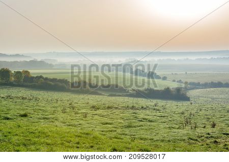 French countryside - Lorraine. French countryside at sunrise with fog.
