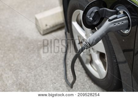 Electric car charging with station Modern eco system Save the earth conception.