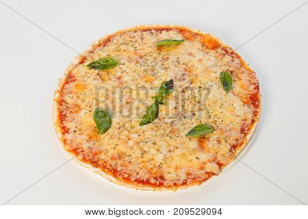 Pizza Margarita With Herbs On A White Background