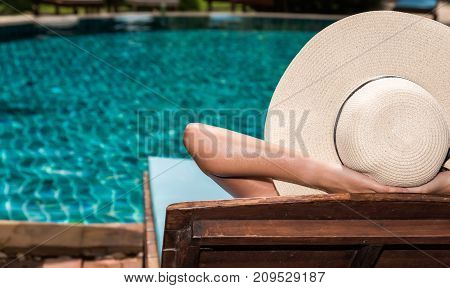 Asian Young Woman In Hat Relaxing Sleep At Poolside