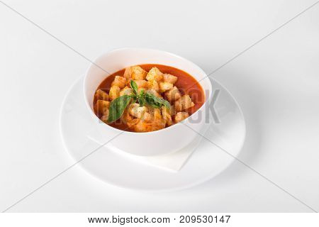 Soup With Rusks On A White Background