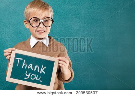 Young boy thinking glasses fun happy person