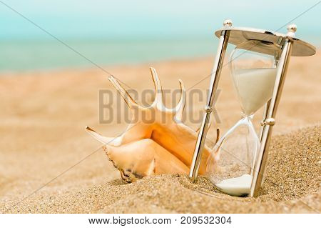 Glass sand hourglass image yellow objects close-up