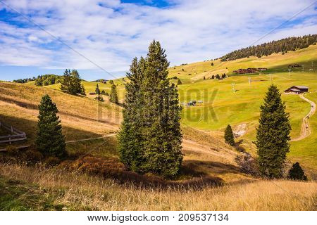 The landscape of the Alps di Siusi. The winter ski resort in autumn. The concept of an active and eco-tourism. Fabulous mountain valley