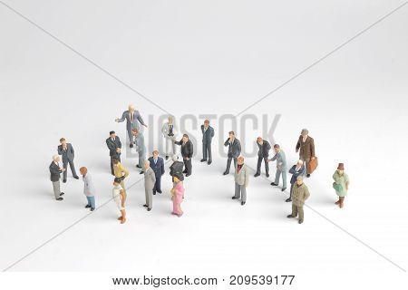 Mini Model Group Of Investor Standing Together Isolated