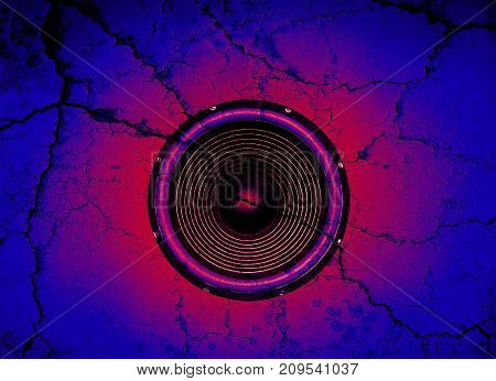 Red audio speaker on a blue cracked wall background