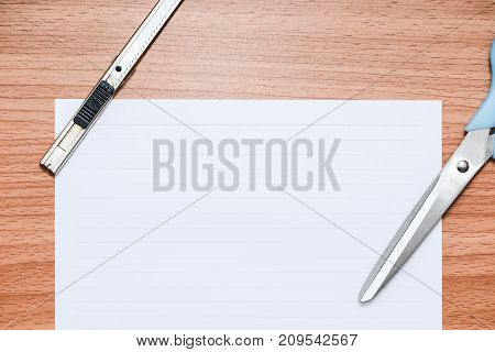 White line paper with official tools on brown wooden table top view