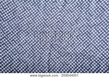 Blue polka dots fabric background for texture and design
