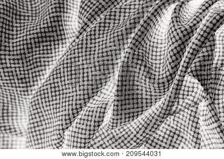 Grey polka dots fabric background for texture and design