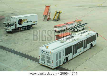 BANGKOK THAILAND  21 JULY 2017: Ground support equipment and bus waiting for a plane to the gate at the gate in Don Mueang international airport (DMK)