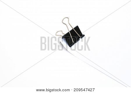 black paper clip (binder) with paper on white background