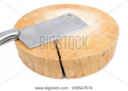 used wooden chopping board made from tree stump with kitchen knife isolated on white background
