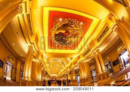 Macau, China - December 8, 2016: The Venetian Luxury Resort and Casino indoor. Majestic corridor with golden decoration and painting on ceiling. The Venetian is the twin Casino of Las Vegas.