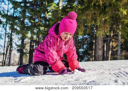 Little Girl Having Fun In The Snow