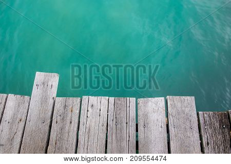the wooden pier over the beautiful sea