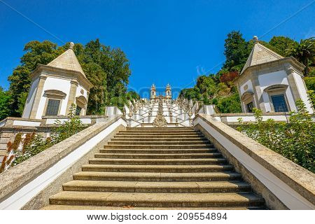 Sanctuary of Bom Jesus do Monte on top of a monumental baroque staircase of 116 meters. Bottom view from down to up. Landmark and popular pilgrimage site in north of Portugal, Tenoes in Braga.