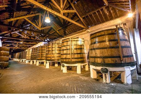 Porto, Portugal - August 13, 2017: wine big barrels in wine cellar of Ferreira Winery in Vila Nova de Gaia, one of most popular wine tasting tours founded by a family of winemakers from Douro in 1751.