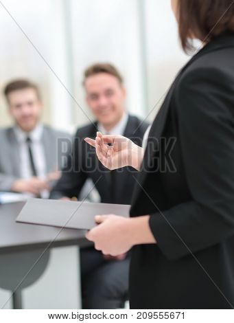 business woman with documents on blurred background office