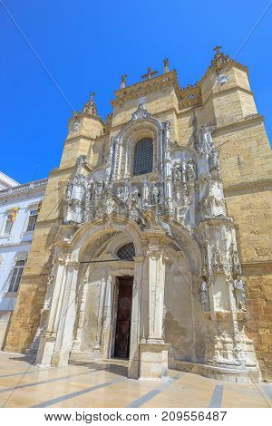Spectacular facade of Santa Cruz Monastery, Praca 8 de Maio, in a sunny day with blue sky. The Church of Santa Cruz is one of the most fascinating religious buildings of Coimbra in Portugal. Vertical.