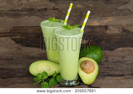 Avocado Smoothies on old wooden floor for good health.