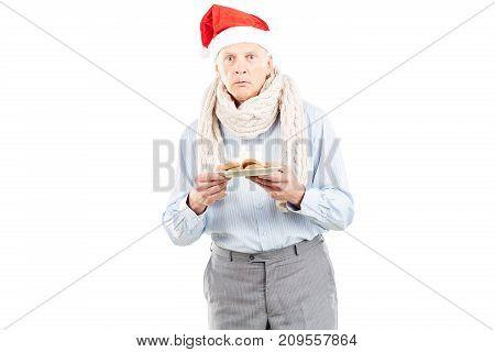 Portrait of senior man in Santa hat on white background