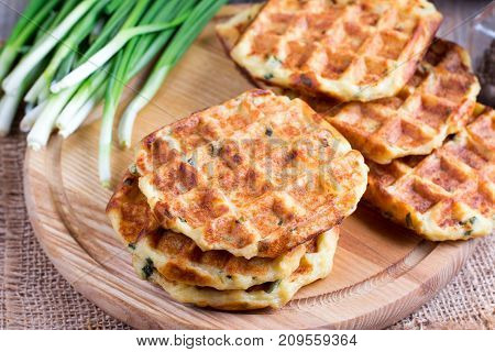 Cheese waffles on a cutting board on a table