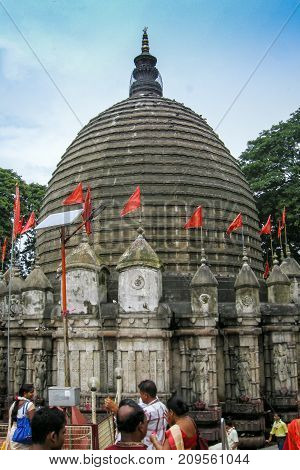 GUWAHATI ASSAM INDIA - JULY 4 2014 : Hindu devotees que at Kamakhya Temple or Kamrup-Kamakhya temple dedicated to the mother goddess Kamakhya. It is famous Hindu religious destination.