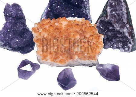 Citrine druzy cluster surrounded by amethyst druzy clusters and points  isolated on white background