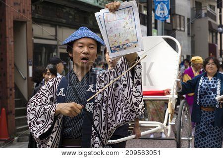 Tokyo, Japan - September 24 2017: Barker Dressed In Traditional Edo Clothing At Shinagawa Shukuba Ma