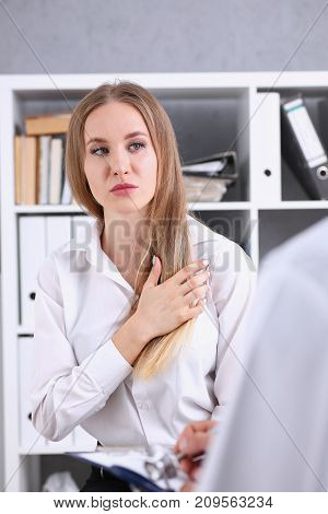 Concerned female visitor portrait talk with doctor filling history list at pad. Physical exam trauma pain disease prevention therapeutist ward round prescribe remedy healthy lifestyle concept