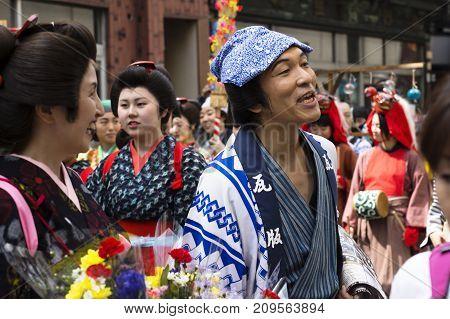 Tokyo, Japan - September 24 2017: Costumed Persons Are Talking With Visitors During Parade At Shinag