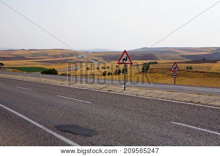 Road with a patch and road signs. Turkey.