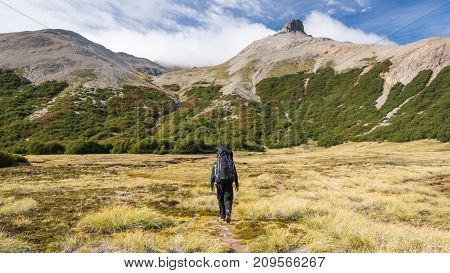 Walking to the mountains in an open valley / Hiking in Patagonia