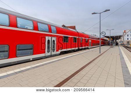 Passenger train near the railway platform in Fussen. Germany. Bavaria.