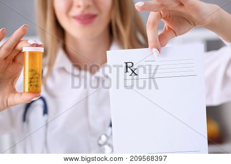 Female doctor hands hold and give to visitor prescription and jar of pills closeup. Panacea life save healthy lifestyle prescribe treatment legal drug store contraception concept
