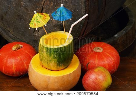 Fresh pumpkin juice in a pumpkin . Autumn cocktails and smoothies