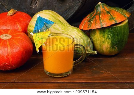 Fresh pumpkin juice in the glass. Autumn cocktails and smoothies