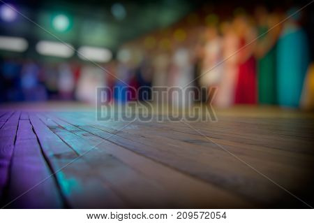 lurred silhouettes of people and dance floor in an open area